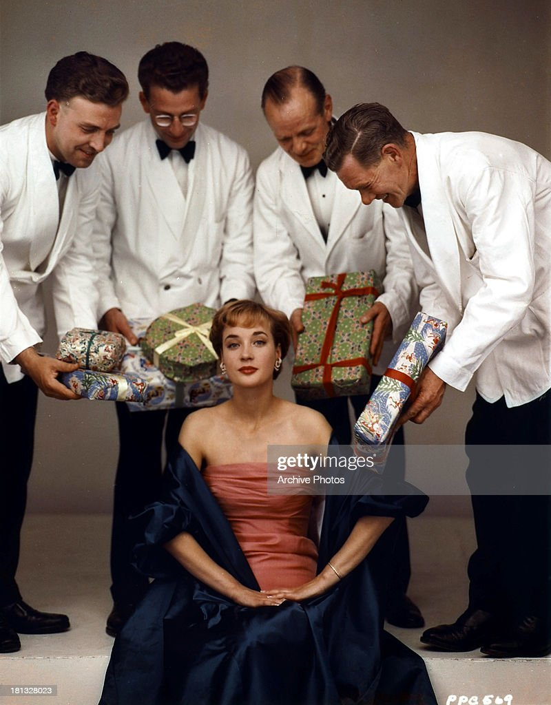 <a gi-track='captionPersonalityLinkClicked' href=/galleries/search?phrase=Sylvia+Syms&family=editorial&specificpeople=235776 ng-click='$event.stopPropagation()'>Sylvia Syms</a> receives gifts in publicity portrait, circa 1965.
