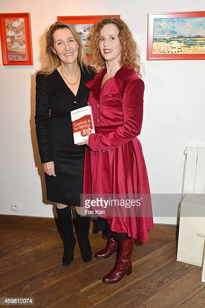 Sylvie Bourgeois Harel and Florence Darel attend the 'Sophie A Les Boules' Sylvie Bourgeois Book Launch Cocktail At Librairie Des Femmes on December...