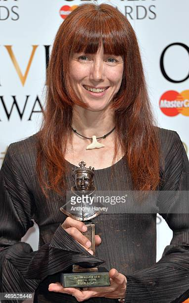 Sylvie Guillem poses in the winners room at The Olivier Awards at The Royal Opera House on April 12 2015 in London England