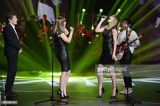 Sylvie Hoarau and Aurelie Saada from the French duo Brigitte perform between French singer Alain Souchon and French singer Laurent Voulzy during the...