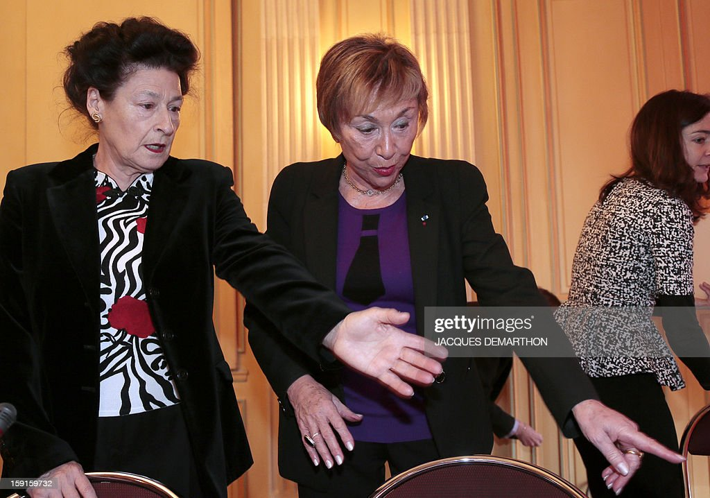 Sylvie Le Bon de Beauvoir (L), daughter of late French philosopher Simone de Beauvoir, speaks with Bulgarian-French philosopher and writer Julia Kristeva (C) during the Simone de Beauvoir awards ceremony, in Paris on January 9, 2013. The 2013 Simone de Beauvoir prize for the freedom of women was handed to Malala Yousafzai, the young Pakistani schoolgirl activist who was the victim of an assasination attempt by the Taliban in 2012 and become a symbol of the struggle for girls' education and women's rights in Pakistan. Malala was flown to the United Kingdom with a life-threatening head wound shortly after her attack but recovered from her injuries and was temporarily discharged on January 4 as she awaits more surgery. AFP PHOTO / JACQUES DEMARTHON