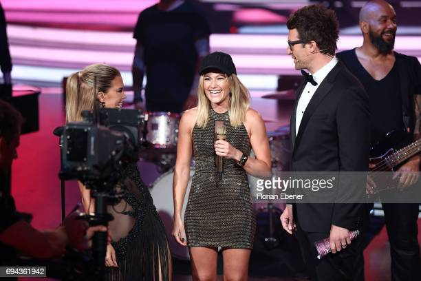 Sylvie Meis Helene Fischer and Daniel Hartwich perform on stage during the final show of the tenth season of the television competition 'Let's Dance'...