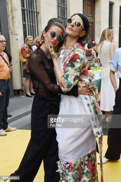 Sylvie Ortega Munos and a model walk the runway during Ken Okada Yellow Carpet Street Show Rue de La Chaise As Part of Faubourg Saint Germain...