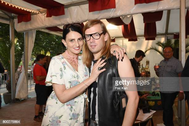 Sylvie Ortega Munos and designer Christophe Guillarme attend La Fete des Tuileries on June 23 2017 in Paris France
