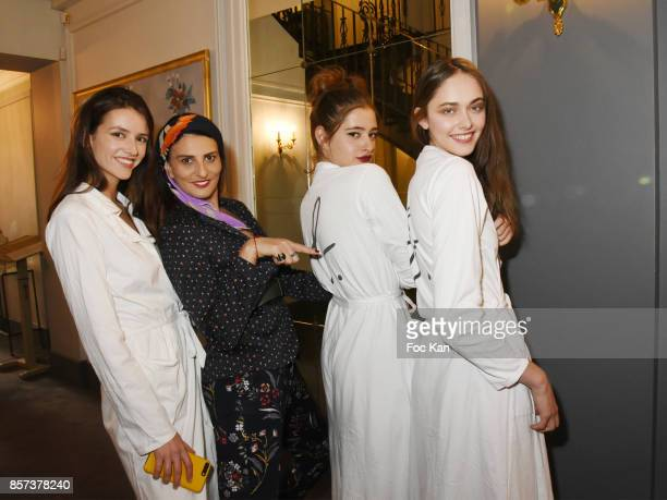 Sylvie Ortega Munos and models in white attend the Agnes B Show as part of the Paris Fashion Week Womenswear Spring/Summer 2018 on October 3 2017 in...