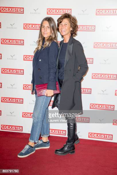 Sylvie Rousseau and her daughter attend 'Coexister' Paris Premiere at Le Grand Rex on September 25 2017 in Paris France