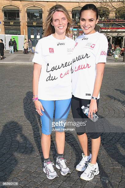Sylvie Tellier and Valerie Begue pose together after their run for the 'Mecenat Chirurgie Cardiaque' association during the Paris marathon on April...