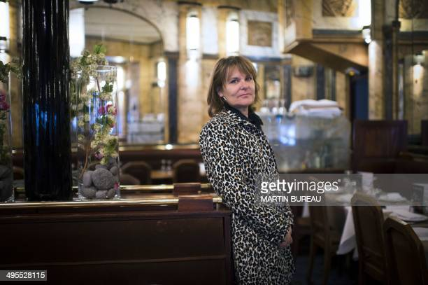 Sylvie Uderzo the daughter of Albert Uderzo coauthor of French comic strip 'Asterix' poses on June 4 2014 at the Vaudeville restaurant in Paris AFP...