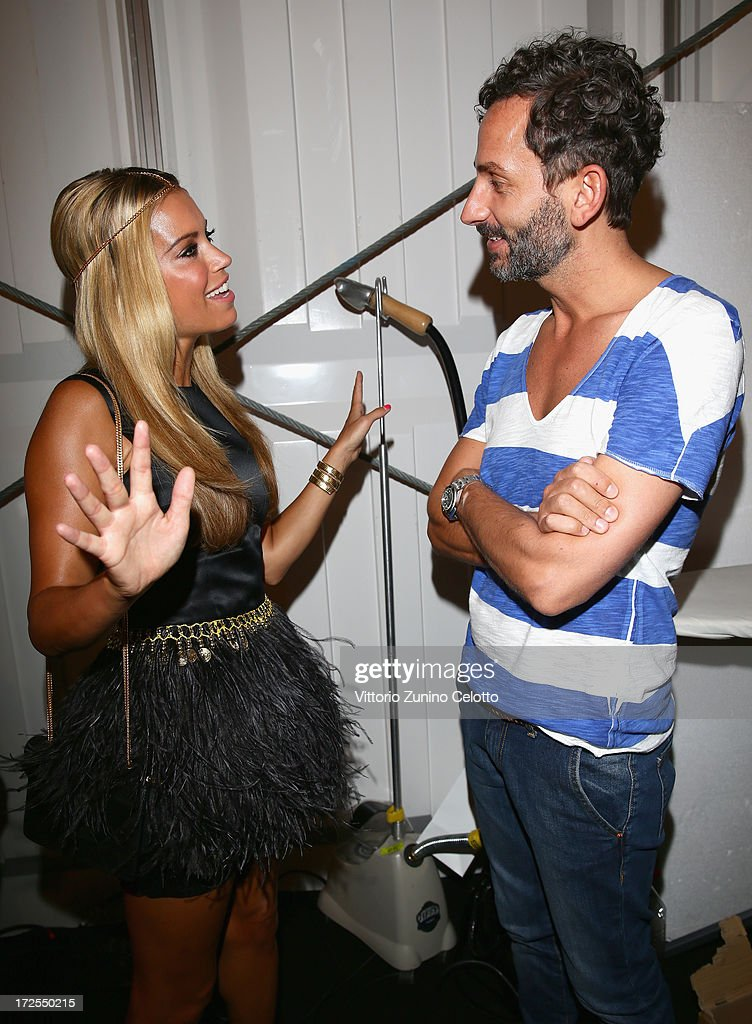 Sylvie van der Vaart and fashion designer Dimitrios Panagiotopoulos backstage ahead of the Dimitri show during Mercedes-Benz Fashion Week Spring/Summer 2014 at Brandenburg Gate on July 3, 2013 in Berlin, Germany.