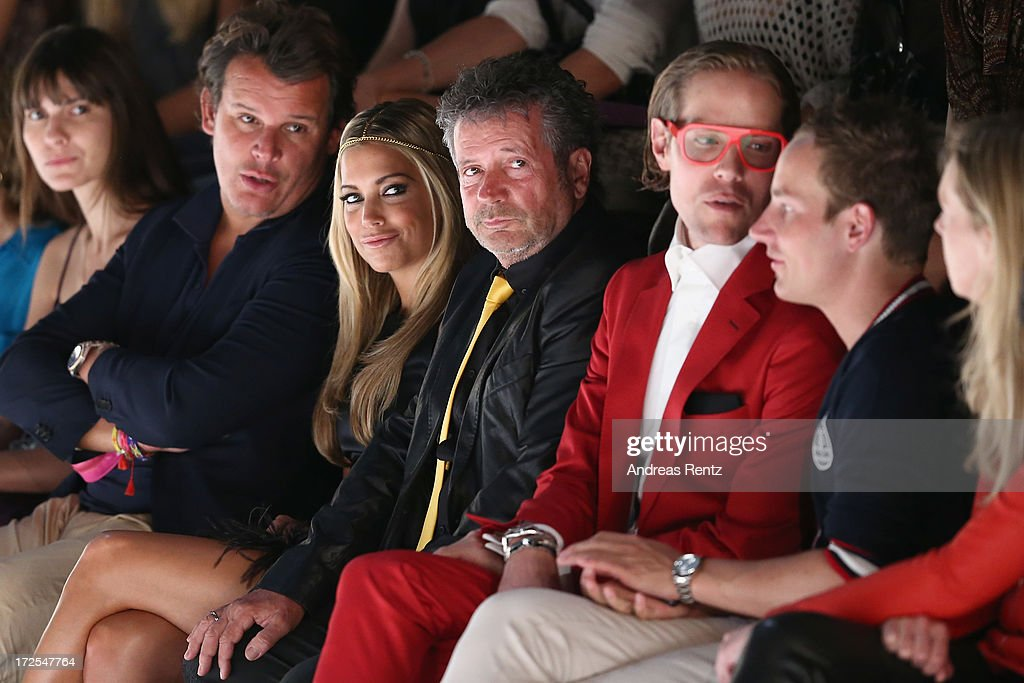 Sylvie van der Vaart (3rdL) attends the Dimitri show during the Mercedes-Benz Fashion Week Spring/Summer 2014 at the Brandenburg Gate on July 3, 2013 in Berlin, Germany.