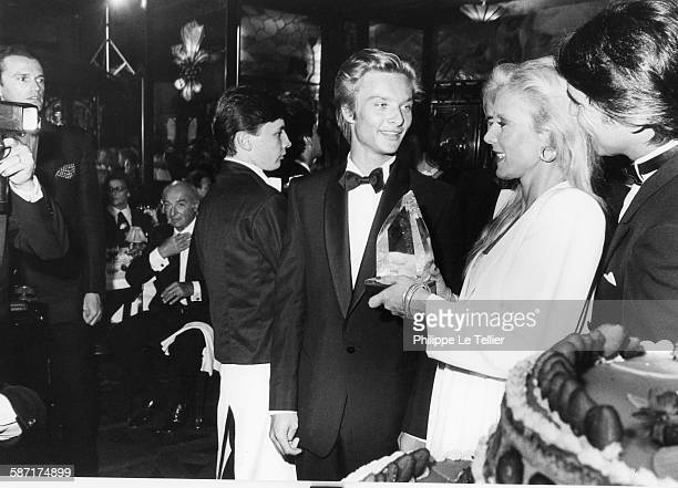 Sylvie Vartan celebrates twenty years of songs in Maxim's restaurant here David Hallyday And Tony Scotti Paris France 1984