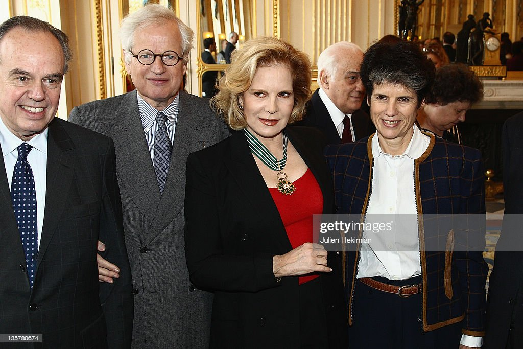 <a gi-track='captionPersonalityLinkClicked' href=/galleries/search?phrase=Sylvie+Vartan&family=editorial&specificpeople=235775 ng-click='$event.stopPropagation()'>Sylvie Vartan</a> poses with French Minister for Culture <a gi-track='captionPersonalityLinkClicked' href=/galleries/search?phrase=Frederic+Mitterrand&family=editorial&specificpeople=621709 ng-click='$event.stopPropagation()'>Frederic Mitterrand</a> (L), Valerie-Anne Giscard d'Estaing (R) and Bernard Fixot after she was awarded Commandeur des Arts et Lettres at Ministere de la Culture on December 14, 2011 in Paris, France.