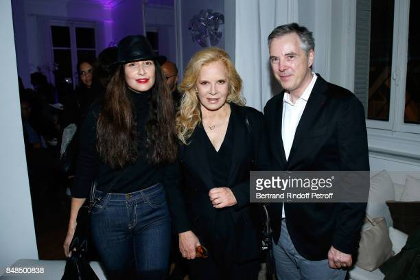 Sylvie Vartan standing between Stylist of Sylvie's Scene Costume Olivier Lapidus and his wife Yara Lapidus attend the Dinner after Sylvie Vartan...