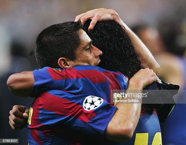 Sylvinho and Ronaldinho of Barcelona embrace following the UEFA Champions League Final between Arsenal and Barcelona at the Stade de France on May 17...