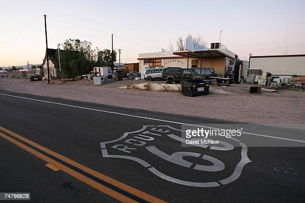 A symbol based on the original Route 66 road signs is seen painted on the highway on June 16 2007 in Daggett California Route 66 opened in 1926 to...