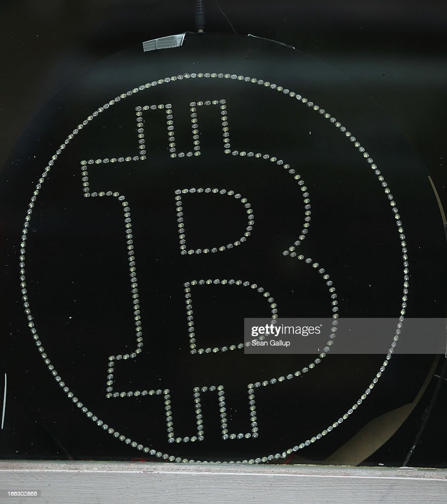 A symbol in the window of a local pub indicates the acceptance of Bitcoins for payment on April 11, 2013 in Berlin, Germany. Bitcoins are a digital currency traded on the MTGox exchange, and the value of the virtual money fluctuated from USD 260 per bitcoin down to USD 130 per bitcoin yesterday and recovered somewhat in trading today.