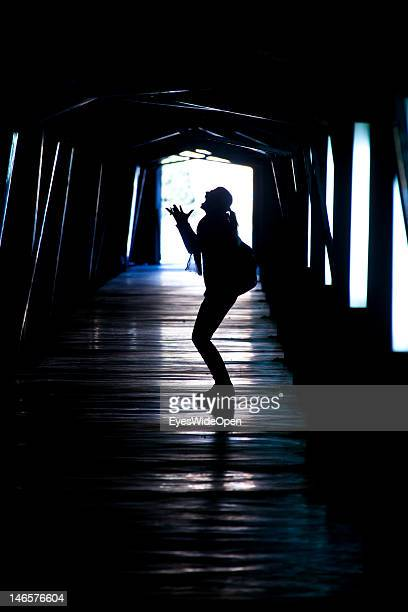 Symbol of a person woman in a depressive pychological crisis after a breakup divorce in a tunnel on Feb 21 2012 in Denia Spain