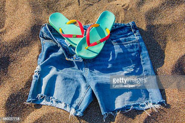 Symbol of things tourists may need in their holidays on the beach like sunhat bathing shoes Flip Flops sunglasses and a bikini on June 28 2015 in...
