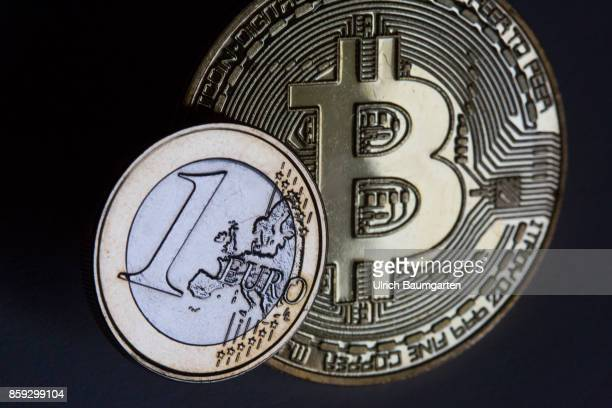 Symbol photo on the subject Bitcoin Euro crypto currency crime digital currency etc The picture shows a Bitcoin and a one euro coin