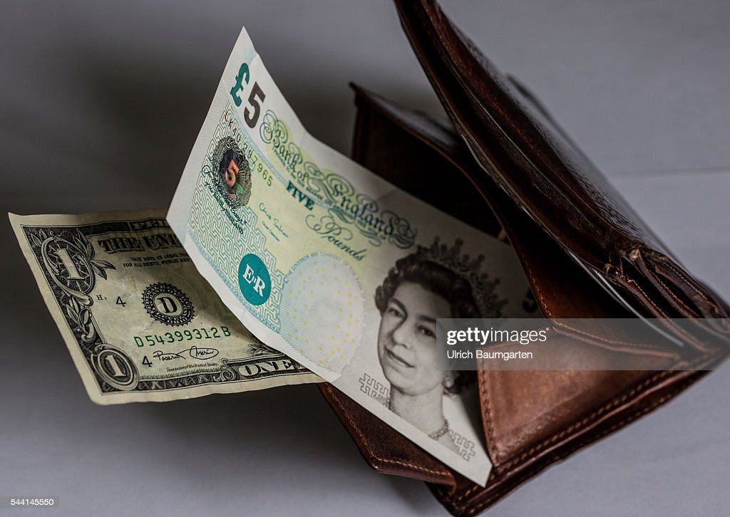 Symbol photo on the subjects Brexit, British Pounds Sterling, Dollar, financel market, stock exchange, etc. The photo shows a wallet with a British 5 Pounds banknote and a 1 Dollar banknote.