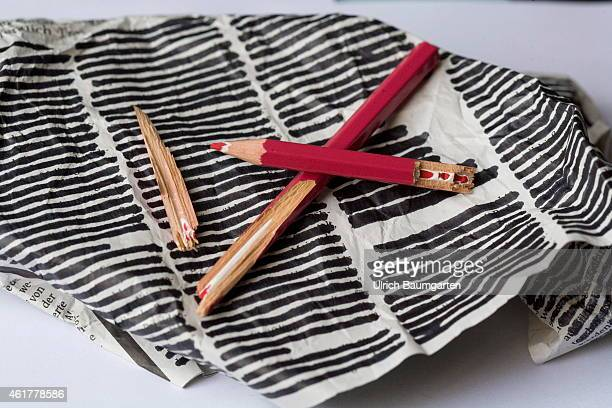 Symbol photo on the topic censoreship Broken red pencil on censored newspaper article on January 19 2015 in Bonn Germany