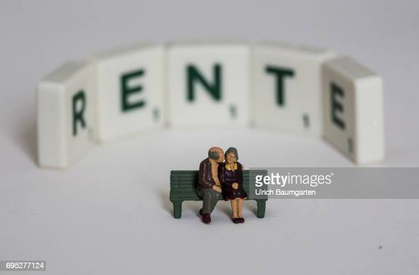 Symbol photo on the topic Pension The photo shows the word Rente composed of Scrabble stones with pensioner miniature figures