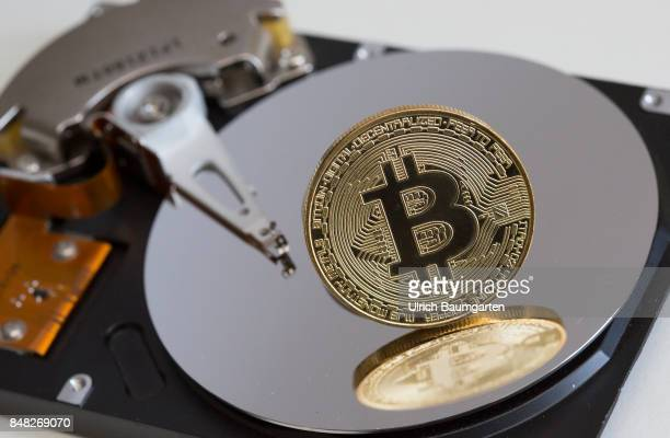 Symbol photo on the topics of Bitcoin Crypto currency financial speculation digital currency etc Bitcoin on a computer hard drive