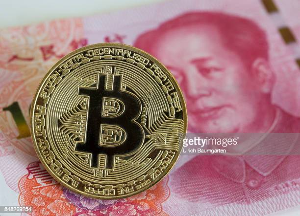 Symbol photo on the topics of Bitcoin Crypto currency financial speculation digital currency China etc Bitcoin on a Chinese100 Yuan banknote