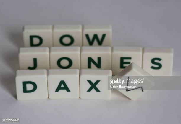 Symbol photo on the topics world economy world finance Dow Jones German stock index etc The photo shows the words Dow Jones and DAX composed of...