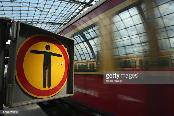 A symbol with a human figure on it marks the end of a train platform at Hauptbahnhof main railway station on August 13 2013 in Berlin Germany A lack...