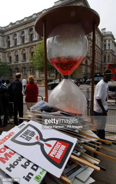A symbolic egg timer full of 'blood' during a demonstration opposite Downing Street to press the Government to assist in protecting victims of the...