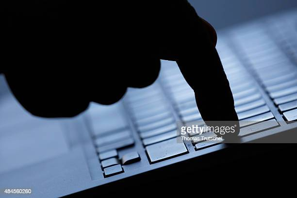 Symbolic feature with topic online crime data theft and piracy here a finger on the keyboard of a computer on Augut 20 2015 in Berlin Germany