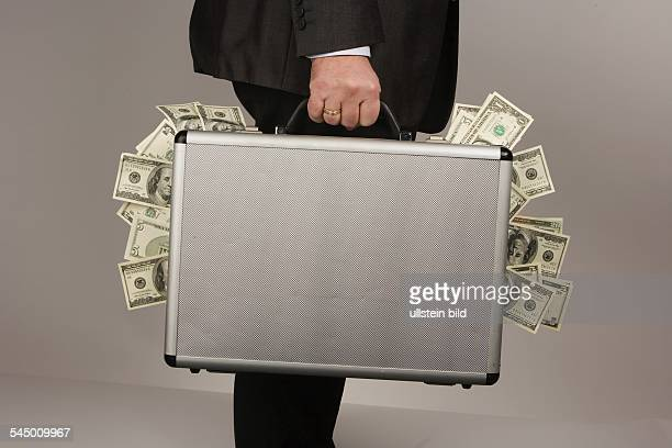 symbolic photo corruption black money illegal earnings man is carrying a briefcase with dollar banknotes
