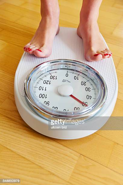 symbolic photo diet weight woman on scales