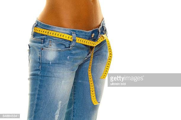 symbolic photo diet woman wearing jeans with measuring tape