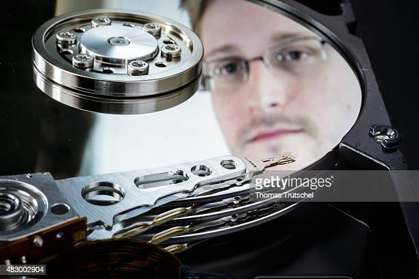 Symbolic photo for data protection closeup of a computer hard drive with a reflection of whistleblower Edward Snowden on August 05 2015 in Berlin...