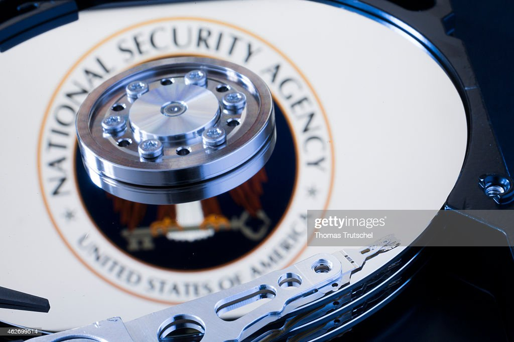 Symbolic photo for data protection reflection of the seal of the National Security Agency in a computer hard drive on January 29 2015 in Berlin...