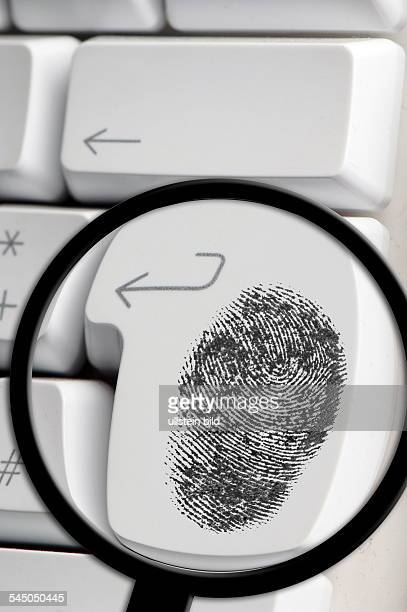 symbolic photo online searching spyware finger print on a keyboard