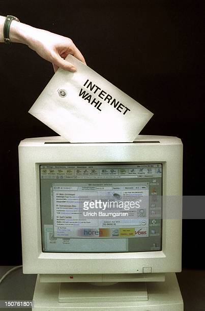 Symbolic photo to the topic ' Internet election ' Computer as a ' letter box ' for election envelope
