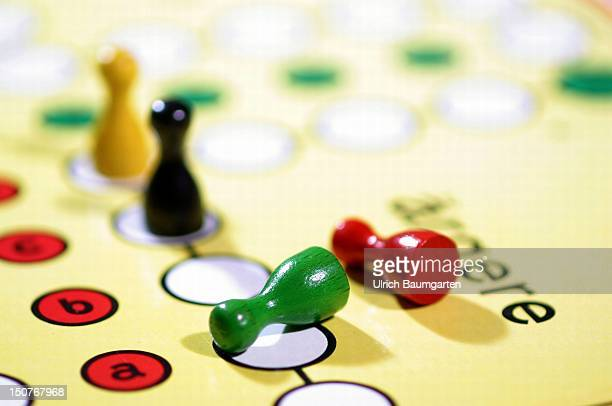 Symbolic picture Fall of the redgreen government by BlackYellow Ludo pieces in the colours red green black and yellow on the board