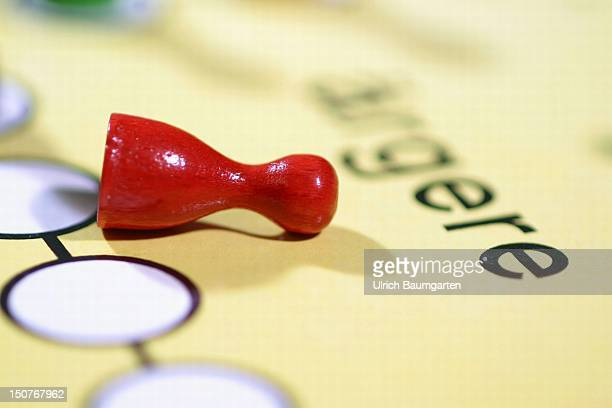 Symbolic picture The fall of the SPD A red tipped over Ludo piece on the board