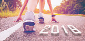 2019 symbolises the start into the new year.Start of people  running on street,with sunset light.Goal of Success