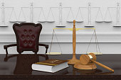 3D illustration. Symbols of law and justice resting on a reflecting plane.
