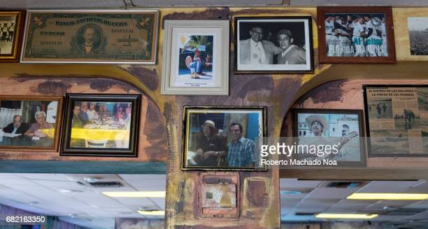 Symbols of the Cuban exiles and immigrants nostalgia in Little Havana's 'Calle Ocho' Old photos decorating a restaurant cafeteria