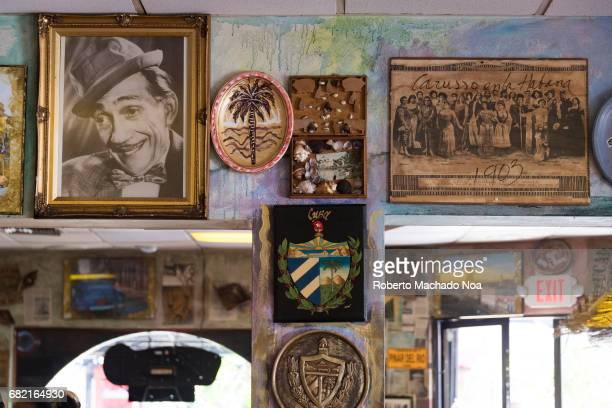Symbols of the Cuban exiles and immigrants nostalgia in Little Havana's 'Calle Ocho' Cuban coat of arms and old photos decorating a cafeteria...