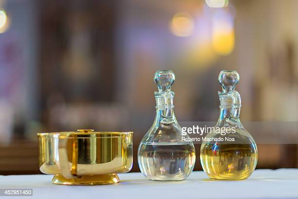 Symbols of the traditions of a Catholic Church Holy water and oil for unction