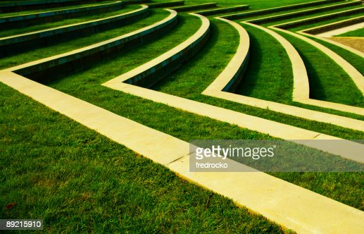Symmetrical Green Grass Lawn with Rows of Steps at a Park