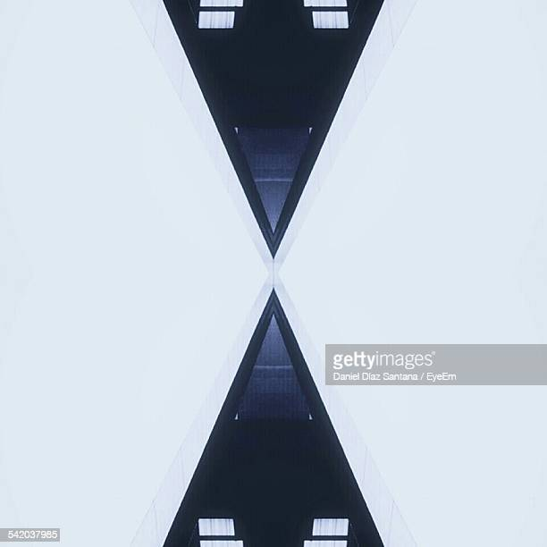 Symmetrical Triangles On White Background