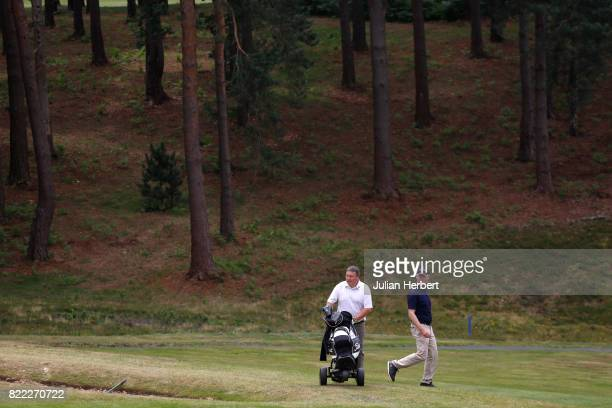 Symon O' Keefe and Dave Nathan of Sand Martins Golf Club head to the 18th green during The Lombard Trophy PGA South Qualifier at Camberley Heath Golf...