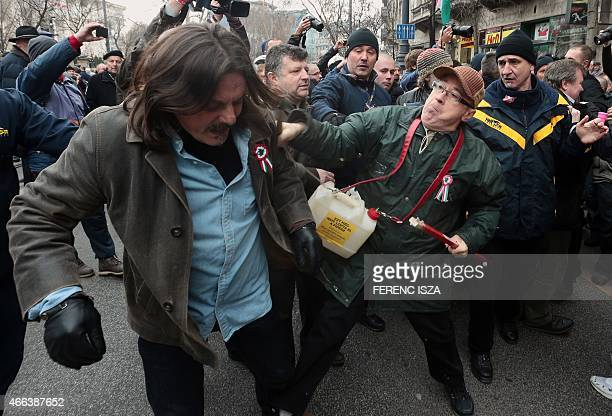 Sympathizers of Hungarian Prime Minister and antigovernment demonstrators fight nearby the National Museum in Budapest Hungary on March 15 during the...